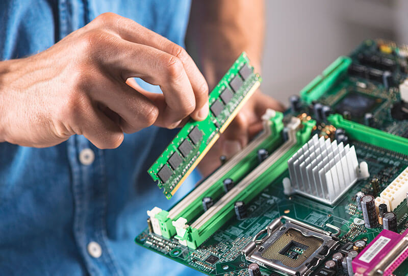 Man installing RAM into mother board