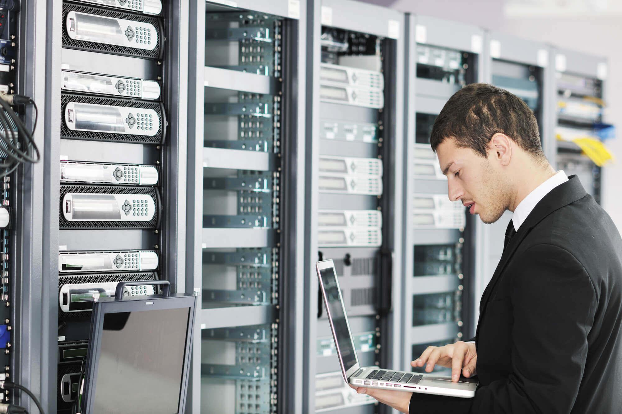 IT tech working on server racks